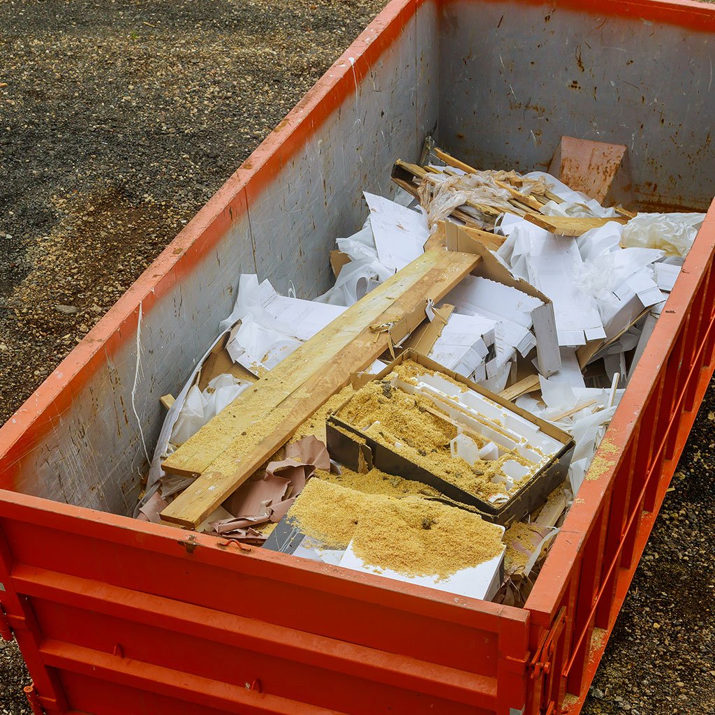 Construction Debris and Trash in a metal Dumpster