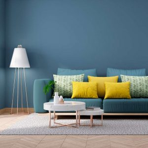 Blue wall with wood floor