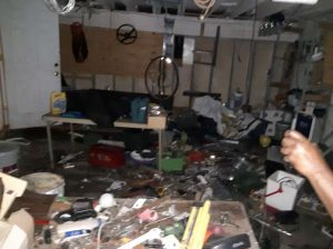 Dirty Garage with junk everywhere on the floor